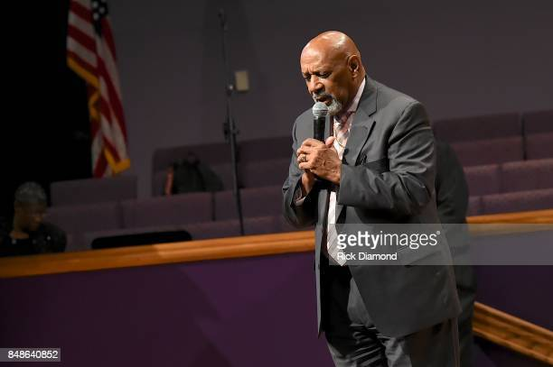 Bishop Jerry Maynard prays during an Evening with Richard Smallwood and Yolanda Adams benefiting The National Museum Of African American Music at Mt...