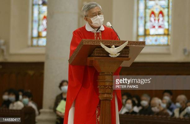 Bishop Joseph Zen gives homily during church service on Good Friday in Hong Kong's Roman Catholic Cathedral in Central district wearing a mask to...