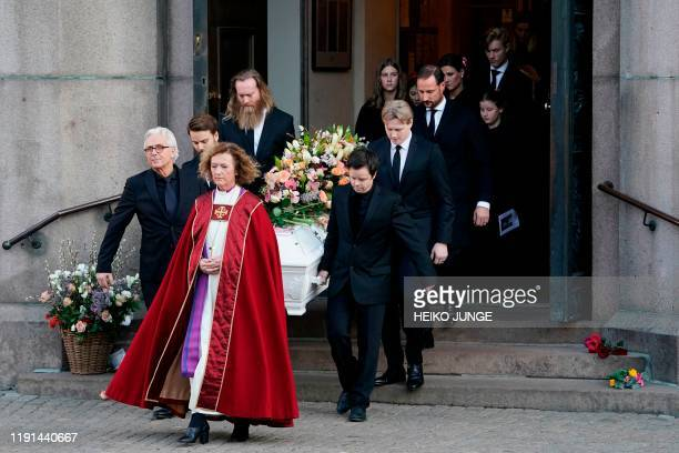 Bishop Kari Veiteberg walks in front of family members carrying the coffin of Ari Behn exhusband of Princess Märtha Louise outside Oslo Cathedral...