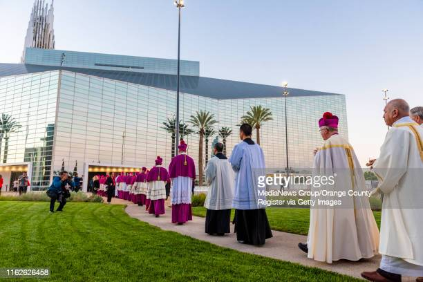 Bishop Kevin Vann, second from right, walks in a procession with other clergy during the Solemn Evening Prayer and Vigil with the Relics at Christ...