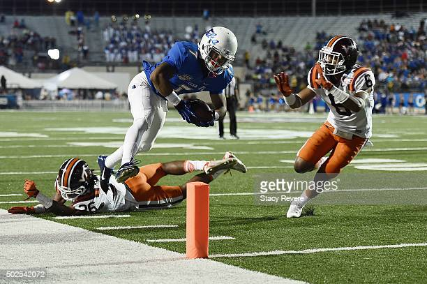 Bishop Louie of the Tulsa Golden Hurricane scores a touchdown in front of Mook Reynolds of the Virginia Tech Hokies during the first half of the...