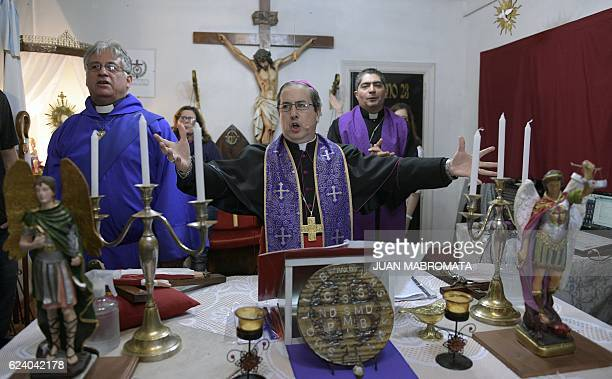 Bishop Manuel Acuna leads a ritual assisted by deacon Jorge Ott and priest Luis Luna at the 'El Buen Pastor' parish in Santos Lugares outskirts of...