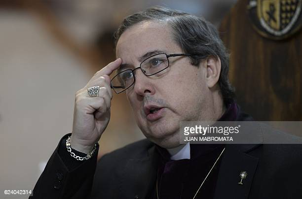 Bishop Manuel Acuna speaks with AFP at the 'El Buen Pastor' parish in Santos Lugares outskirts of Buenos Aires on September 6 2016 Acuna who defines...