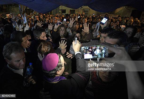 Bishop Manuel performs a ritual at the 'El Buen Pastor' parish in Santos Lugares outskirts of Buenos Aires on September 6 2016 Acuna who defines...