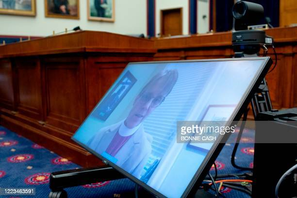 Bishop Mariann Budde of the Esiscopal Diocese of Washington is seen on a screen during a House Natural Resources Committee hearing on The US Park...