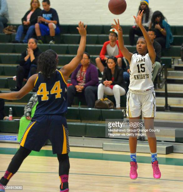 Bishop Montgomery's Courtney Keaton shoots over El Segundo's Myia Mosley in the South Bay Athletic Club's senior allstar basketball game at South...