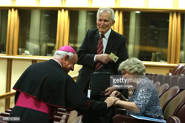 Bishop Msgr Vincenzo Paglia greets a couple before the first sessions of the Synod on the themes of family at the Synod Hall on October 6 2014 in...