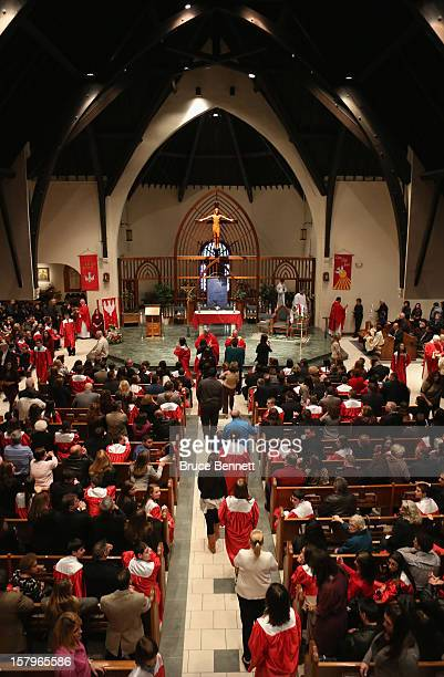 Bishop Nelson J Perez officates over The Sacrament of Confirmation ceremony at The Church of St Martin of Tours on December 7 2012 in Bethpage New...