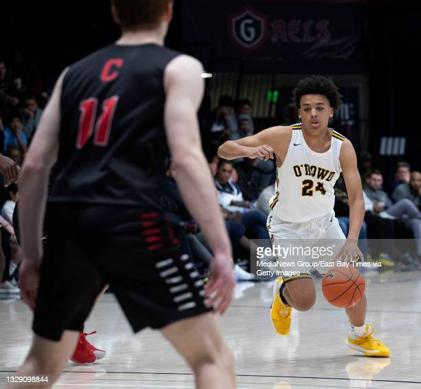 Bishop O'Dowd High School's Jalen Lewis heads down court as Campolindo High moves in on defense during the Martin Luther King Classic basketball...