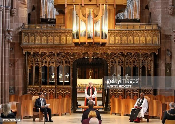 Bishop of Manchester David Walker speaks alongside Mayor of Greater Manchester Andy Burnham and Dean of Manchester Rogers Govender at a memorial...