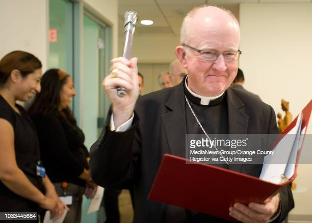 Bishop of Orange Kevin Vann blesses Christ Cathedral's Tower of Hope on Wed. The building, formally part of Crystal Cathedral, was sold to the...
