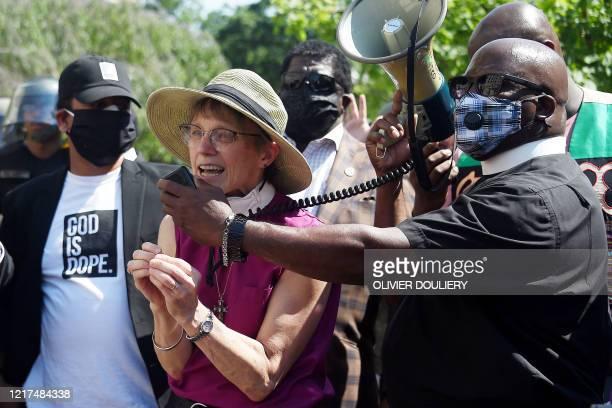 Bishop of the Episcopal Diocese of Washington DC Mariann Edgar Budde speaks at a Solidarity Prayer Vigil near St Johns Episcopal Church on June 3 as...
