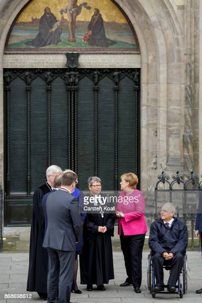 Bishop of the Evangelical Church in Central Germany Ilse Junkermann German Chancellor Angela Merkel and President of the Bundestag Wolfgang Schaeuble...