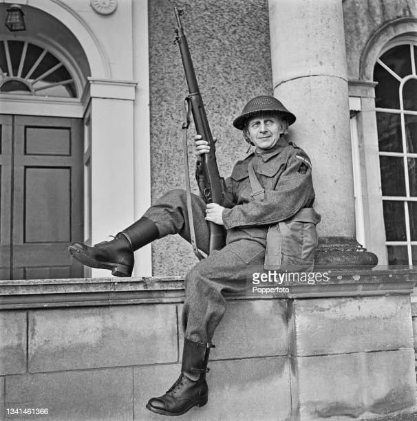 Bishop of Truro Joseph Hunkin posed wearing his Home Guard uniform outside his office in Truro, Cornwall during World War II on 13th February 1942....