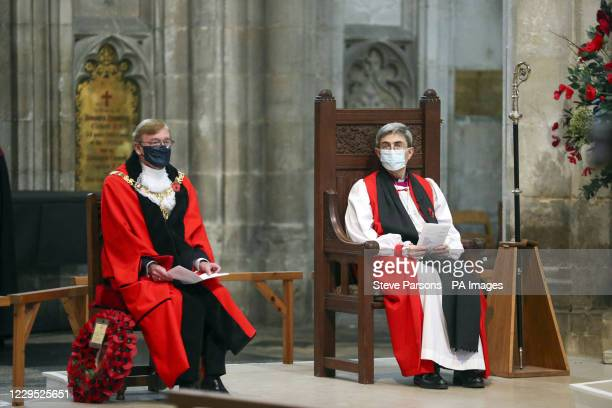Bishop of Winchester, The Right Reverend Dr Tim Dakin and Mayor of Winchester, Cllr Patrick Cunningham , during a remembrance service at Winchester...