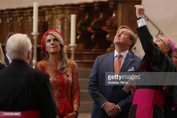 Bishop Stephan Ackermann chats with King WillemAlexander of The Netherlands and Queen Maxima of The Netherlands during their visit at the High...