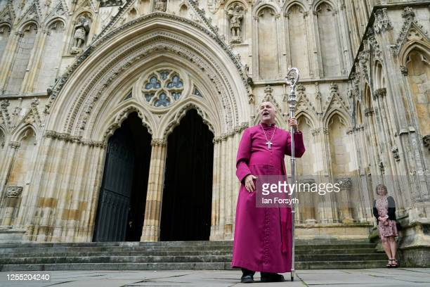 Bishop Stephen Cottrell addresses members of the congregation as his wife Rebecca looks on outside the West Door of York Minster following his...