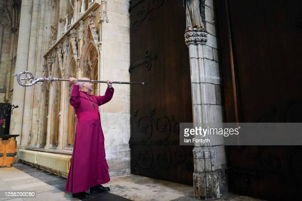 Bishop Stephen Cottrell knocks three times on the inside of the West Door of York Minster with his Crozier following his Confirmation of Election as...