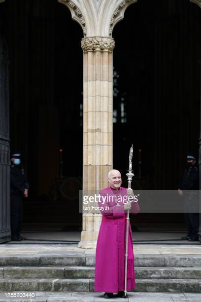 Bishop Stephen Cottrell poses for pictures after he walks through the West Door of York Minster following his Confirmation of Election as the 98th...