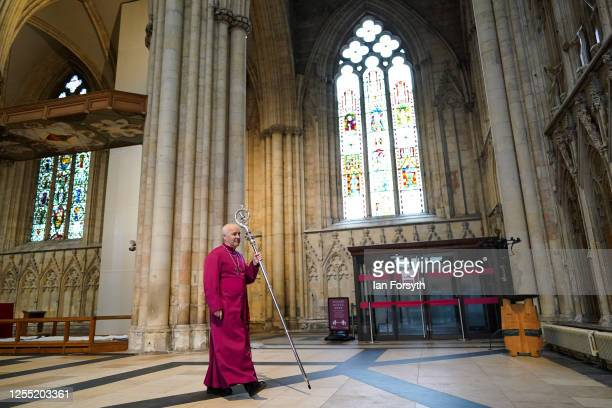 Bishop Stephen Cottrell prepares to knock three times on the inside of the West Door of York Minster with his Crozier following his Confirmation of...