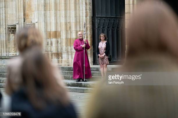 Bishop Stephen Cottrell stands with his wife Rebecca outside the West Door of York Minster following his Confirmation of Election as the 98th...