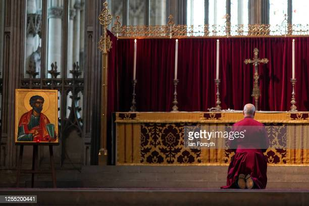 Bishop Stephen Cottrell takes a moment of prayer before he takes up the historic Braganza Crozier his staff of office from the alter within the Quire...
