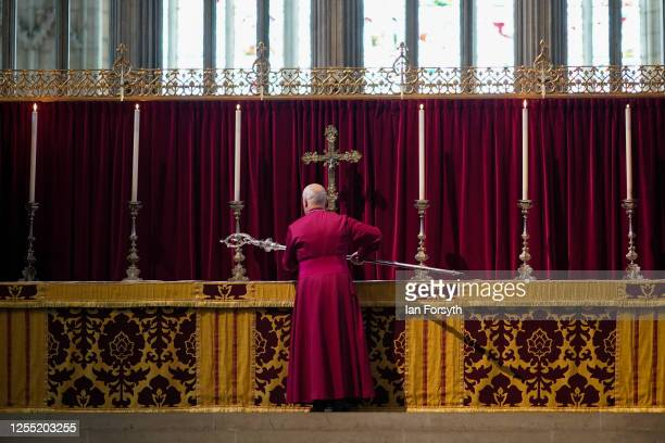 Bishop Stephen Cottrell takes up the historic Braganza Crozier his staff of office from the alter within the Quire of York Minster in front of a...