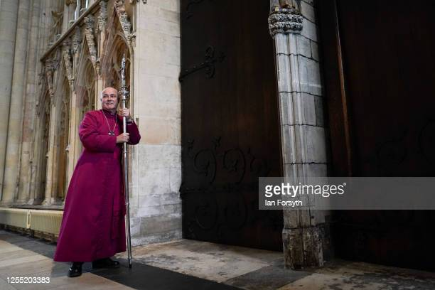 Bishop Stephen Cottrell turns after knocking three times on the inside of the West Door of York Minster with his Crozier following his Confirmation...