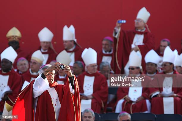 Bishop takes a photograph at the Opening Mass formally celebrating the start of World Youth Day 2008 at Barangaroo on July 15, 2008 in Sydney,...
