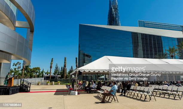 Bishop Thanh Thai Nguyen, left, celebrates an outdoor mass at Christ Cathedral in Garden Grove on Sunday, July 19, 2020. Services at Christ Cathedral...