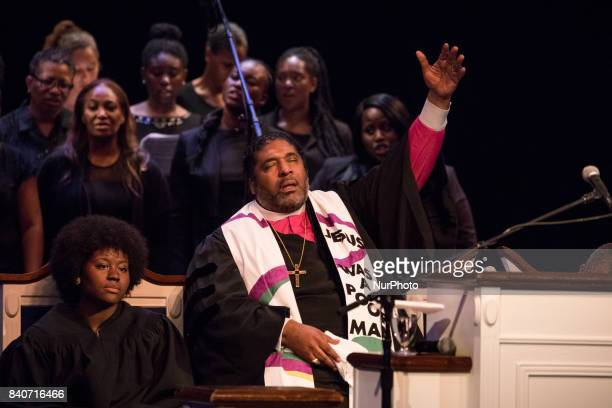 Bishop William J Barber II Pastor Greenleaf Christian Church Disciples of Christ Goldsboro NC sings along with the choir before giving the sermon at...