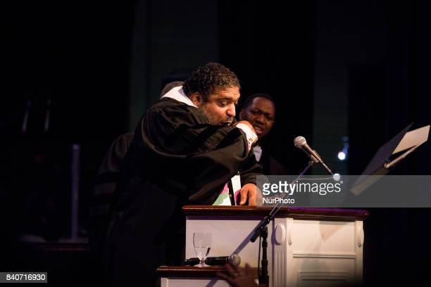 Bishop William J Barber II Pastor Greenleaf Christian Church Disciples of Christ Goldsboro NC tosses his binder from the pulpit during his sermon at...