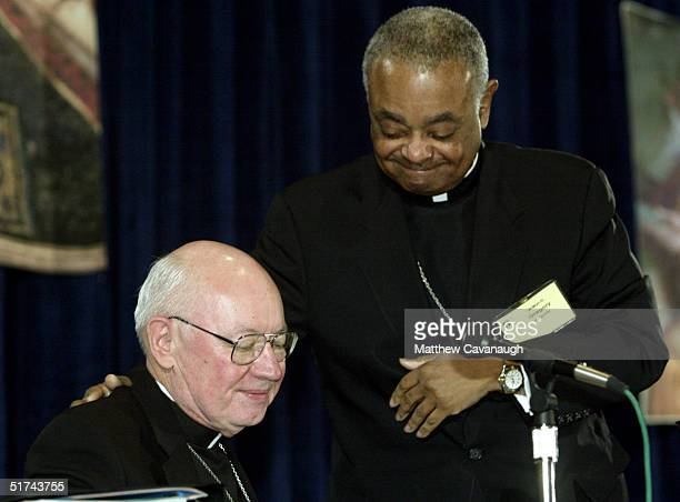 Bishop William Skylstad of Spokane Washington is congratulated by Bishop Wilton Gregory during the US Conference of Catholic Bishops meeting November...