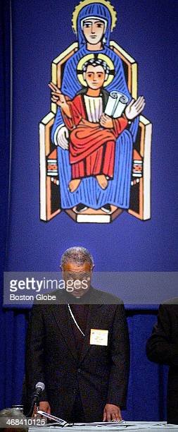 Bishop Wilton Gregory President of the USCCB prays during the opening session of the United States Conference of Catholic Bishops at the Fairmont...