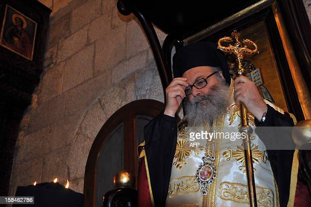 Bishop Yuhanna Yazigi crosses himself at his inauguration ceremony at the Balamand Monastery north of Beirut after he was elected as the new...