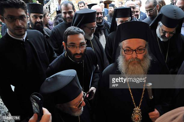Bishop Yuhanna Yazigi enters the Balamand Monastery north of Beirut for his inauguration ceremony on December 17 after he was elected as the new...