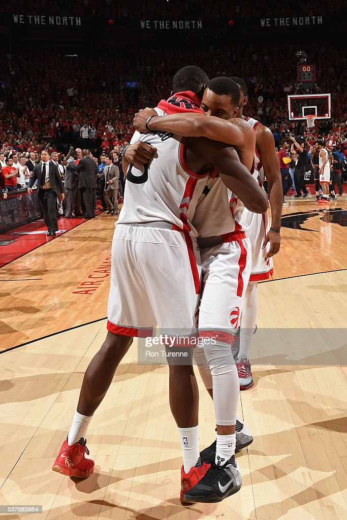 Bismack Biyombo #8 and Kyle Lowry #7 of the Toronto Raptors hug after Game Six of the NBA Eastern Conference Finals against the Cleveland Cavaliers at Air Canada Centre on May 27, 2016 in Toronto, Ontario, Canada.