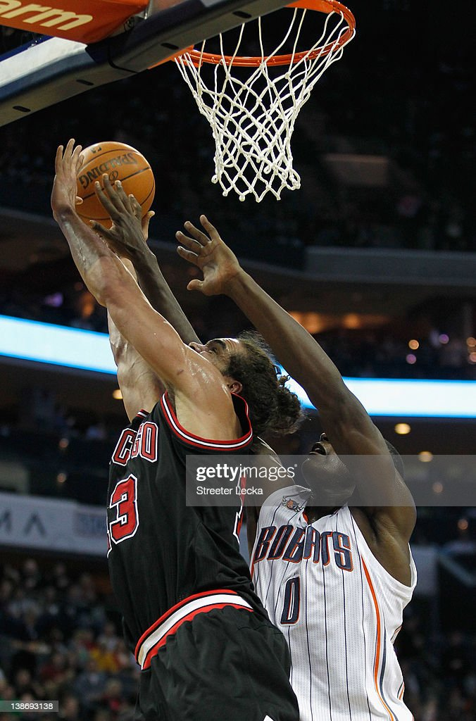 Bismack Biyombo #0 of the Charlotte Bobcats fouls Joakim Noah #13 of the Chicago Bulls during their game at Time Warner Cable Arena on February 10, 2012 in Charlotte, North Carolina.