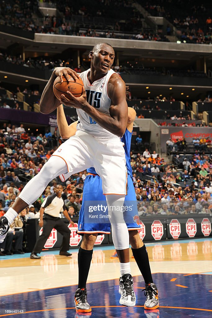 Bismack Biyombo #0 of the Charlotte Bobcats goes up for the rebound against the New York Knicks at the Time Warner Cable Arena on April 15, 2013 in Charlotte, North Carolina.