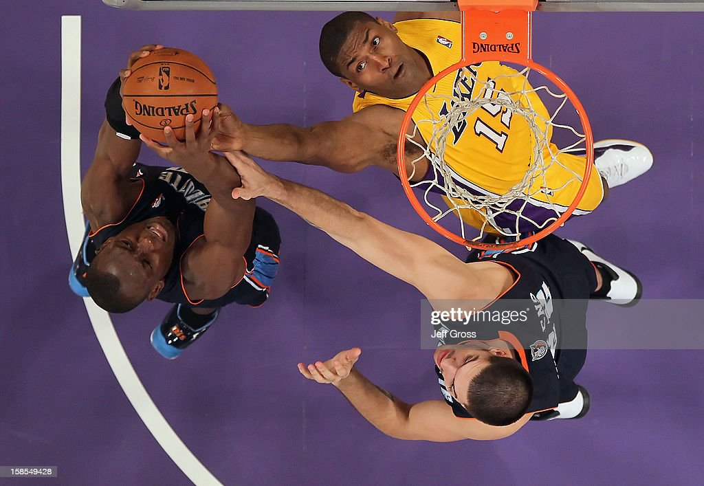 Bismack Biyombo #0 of the Charlotte Bobcats, Metta World Peace #15 of the Los Angeles Lakers and Byron Mullens #22 of the Charlotte Bobcats fight for a rebound in the first half at Staples Center on December 18, 2012 in Los Angeles, California. The Lakers defeated the Bobcats 101-100.