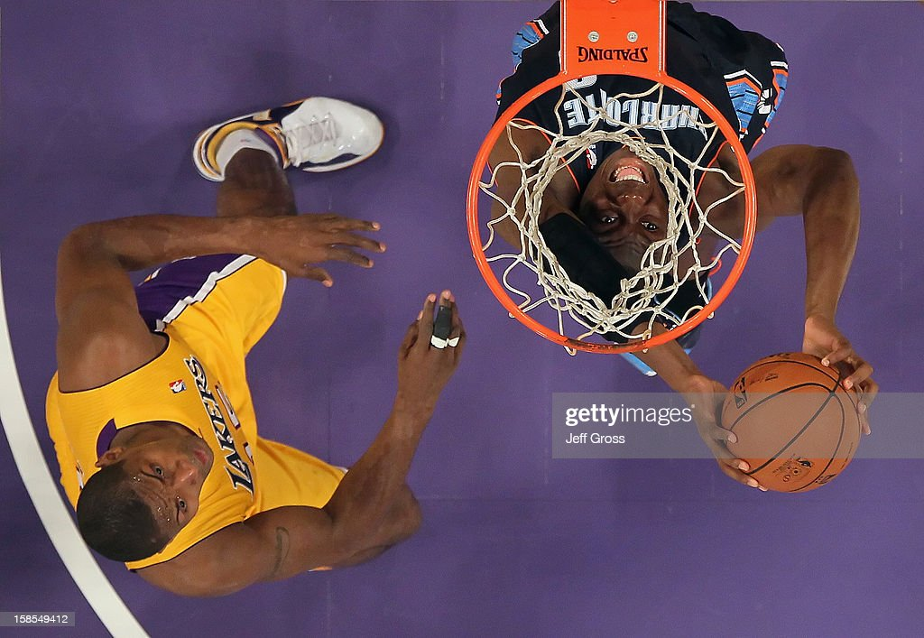 Bismack Biyombo #0 of the Charlotte Bobcats puts back a rebound, as Metta World Peace #15 of the Los Angeles Lakers looks on in the first half at Staples Center on December 18, 2012 in Los Angeles, California. The Lakers defeated the Bobcats 101-100.