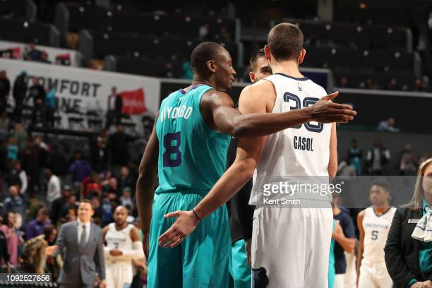 Bismack Biyombo of the Charlotte Hornets and Marc Gasol of the Memphis Grizzlies shake hands after a game on February 1 2019 at Spectrum Center in...