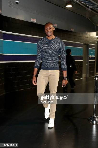 Bismack Biyombo of the Charlotte Hornets arrives to the arena before the game against the Orlando Magic on April 10 2019 at Spectrum Center in...