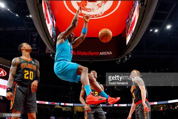 Bismack Biyombo of the Charlotte Hornets dunks during the second half of an NBA game against the Atlanta Hawks at State Farm Arena on March 9, 2020...