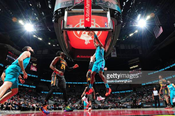 Bismack Biyombo of the Charlotte Hornets dunks the ball against the Atlanta Hawks on March 9, 2020 at State Farm Arena in Atlanta, Georgia. NOTE TO...
