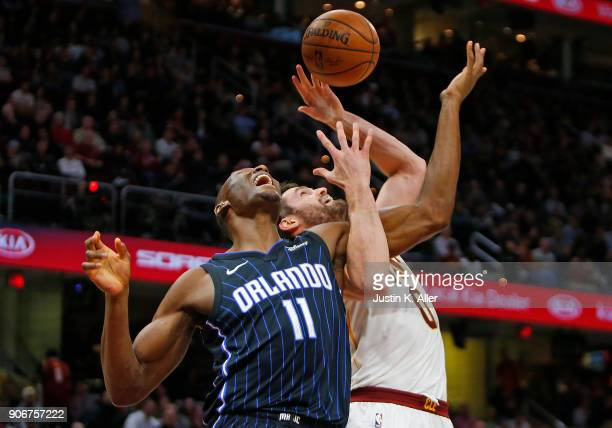 Bismack Biyombo of the Orlando Magic and Kevin Love of the Cleveland Cavaliers battled or a rebound at Quicken Loans Arena on January 18 2018 in...