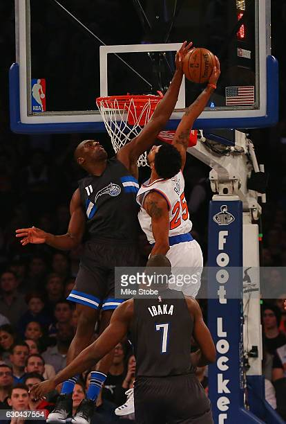 Bismack Biyombo of the Orlando Magic blocks a dunk attempt by Derrick Rose of the New York Knicks at Madison Square Garden on December 22 2016 in New...