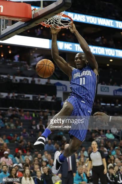 Bismack Biyombo of the Orlando Magic dunks the ball against Charlotte Hornets during their game at Spectrum Center on October 29 2017 in Charlotte...