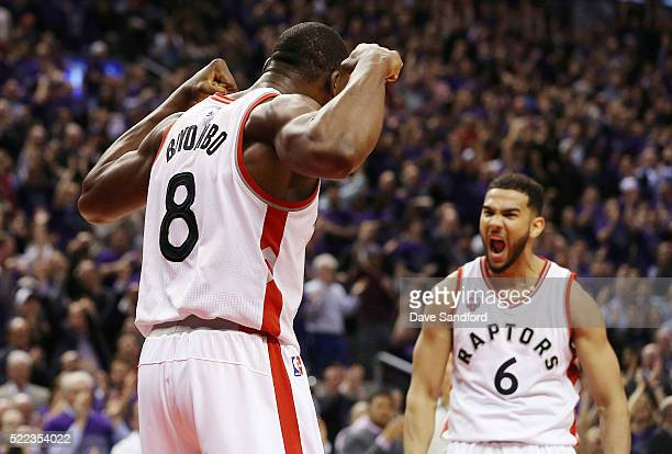 Bismack Biyombo of the Toronto Raptors and Cory Joseph of the Toronto Raptors celebrate during the game against the Indiana Pacers in Game Two of the...