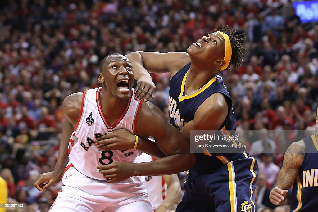 Bismack Biyombo #8 of the Toronto Raptors and Myles Turner #33 of the Indiana Pacers battle for a rebound in Game One of the Eastern Conference Quarterfinals during the 2016 NBA Playoffs on April 16, 2016 at the Air Canada Centre in Toronto, Ontario, Canada.